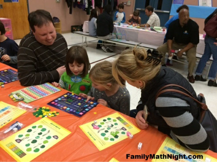 Family playing math activity at event
